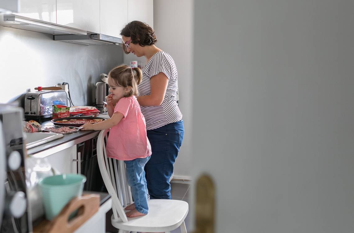 mom with her toddler girl making a pizza in the kitchen by San Diego family lifestyle photographer Diane Hamacher